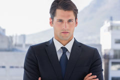 Businessman standing with arms crossed Stock Images