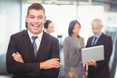 Businessman standing with arms crossed Royalty Free Stock Photos