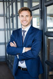 Businessman standing with arms crossed Stock Photography