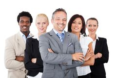 Businessman Standing Arms Crossed With Team Stock Photos