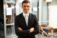 Businessman standing with arms folded Stock Photography