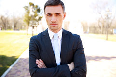 Businessman standing with arms folded o Royalty Free Stock Images