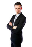 Businessman standing with arms folded Royalty Free Stock Image