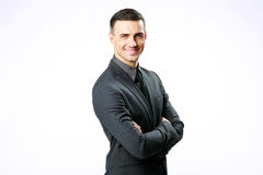 Businessman standing with arms folded Stock Image
