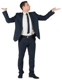 Businessman standing with arms out Royalty Free Stock Photos