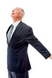 Businessman standing with arms outstretched and day dreaming Royalty Free Stock Photography