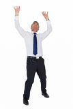 Businessman standing with arms up Royalty Free Stock Images