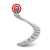 Businessman standing with arms wide open on top of the stairs with red target behind Stock Image