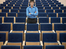 Businessman Standing In Auditorium Royalty Free Stock Photos