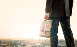 Businessman standing with back against city Stock Photos