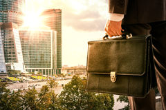 Businessman standing with back against city Stock Images