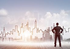 Motivation and inspiration concept with modern cityscape and businessman observing it royalty free stock photo