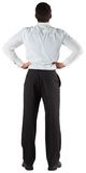 Businessman standing back to the camera with hands on hips Royalty Free Stock Image