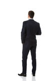 Businessman standing back to camera. Stock Photos