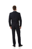 Businessman standing back to camera. Stock Photo
