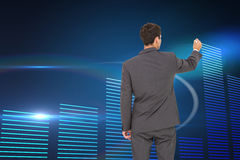 Businessman standing back to camera writing with marker Royalty Free Stock Photography