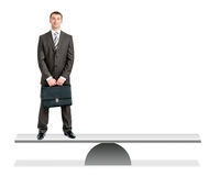 Businessman standing on balance vs empty place Stock Image