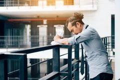 Businessman standing on balcony office room with crumpled paper. stock photos