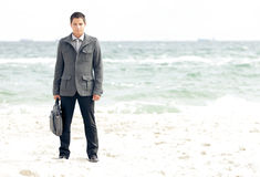 Businessman standing on the beach Royalty Free Stock Image
