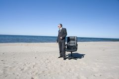 Businessman standing on beach Stock Photos