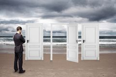 Businessman standing on beach Royalty Free Stock Photography