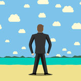 Businessman standing on beach Royalty Free Stock Images