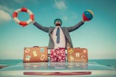 Businessman standing on a beach near car Royalty Free Stock Photo