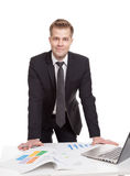 Businessman standing behind the office desk Royalty Free Stock Images