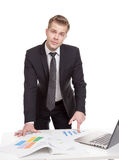Businessman standing behind the office desk Royalty Free Stock Photo