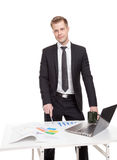 Businessman standing behind the office desk Royalty Free Stock Image