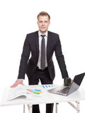 Businessman standing behind the office desk Stock Images