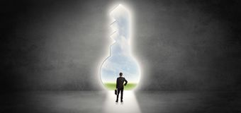 Businessman standing in a big keyhole stock illustration