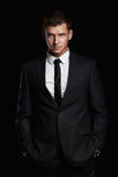 Businessman standing on black background. handsome young Man in suit Royalty Free Stock Image
