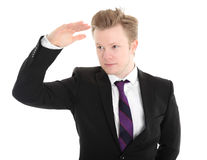 Businessman standing in a black jacket and tie Royalty Free Stock Photos