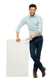 Businessman standing with blank billboard Royalty Free Stock Photos
