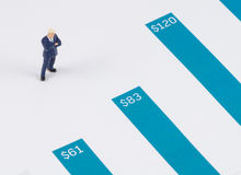 Businessman standing on the blue growth graph Royalty Free Stock Photography
