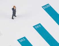 Businessman standing on the blue growth graph Royalty Free Stock Photo