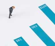Businessman standing on the blue growth graph Stock Photos