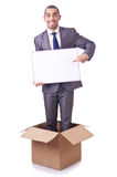 Businessman standing in the box isolated Stock Image