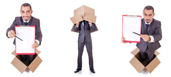 The businessman standing in the box isolated on white Stock Photography