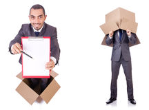 The businessman standing in the box isolated on white Stock Photo