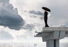 Businessman standing on bridge stock photography
