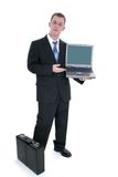 Businessman Standing With Briefcase And Open Laptop Stock Photos