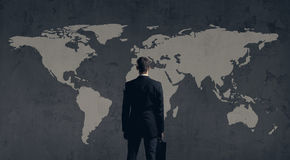Businessman standing  with briefcase. World map background. Busi. Ness, globalization, concept Stock Photo