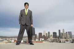 Businessman Standing On Building Rooftop Royalty Free Stock Photos