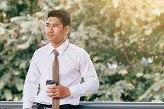 Businessman standing at building walkway company with hope concept. royalty free stock photo
