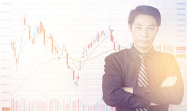 Businessman standing with business charts and graphs Royalty Free Stock Image