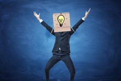Businessman standing with cardboard box on his head Stock Image