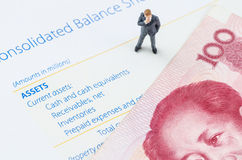 Businessman standing with Chinese banknote on the bala Stock Images