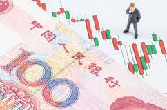 Businessman standing with Chinese banknote on the cand Stock Photo